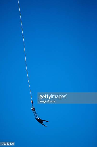 A person bungee jumping