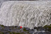 Person by Dettifoss Waterfall, Iceland