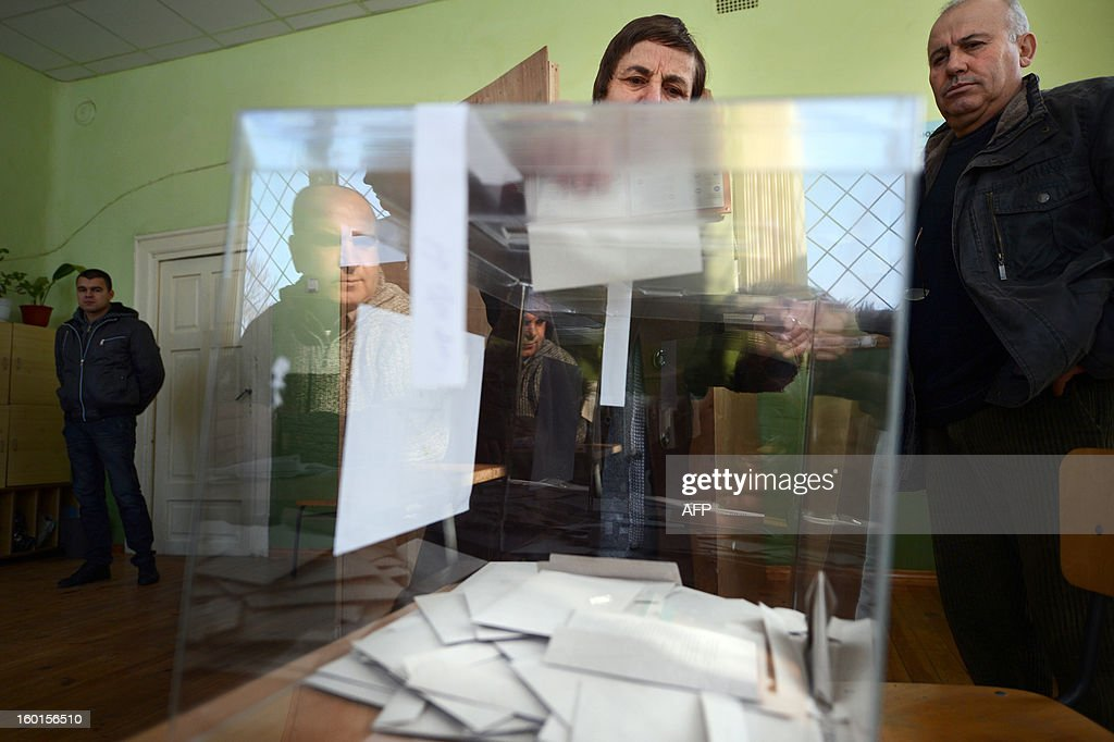 A person casts her ballot at a polling station during the national referendum in the town of Belene on January 27, 2013. Bulgarians voted Sunday on whether to revive plans ditched by the government to construct a second nuclear power plant, in the EU member's first referendum since communism. The referendum asks 6.9 million eligible voters: 'Should Bulgaria develop nuclear energy by constructing a new nuclear power plant ?'.