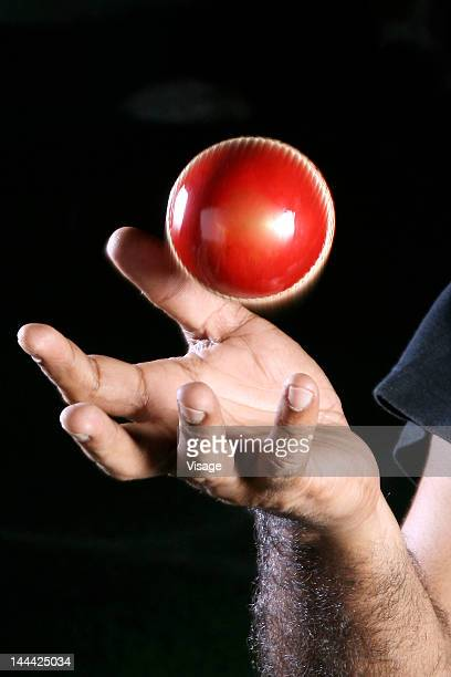 Person catching a Cricket ball