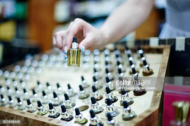 Person choosing a perfume in shop, Zagreb, Croatia, Europe