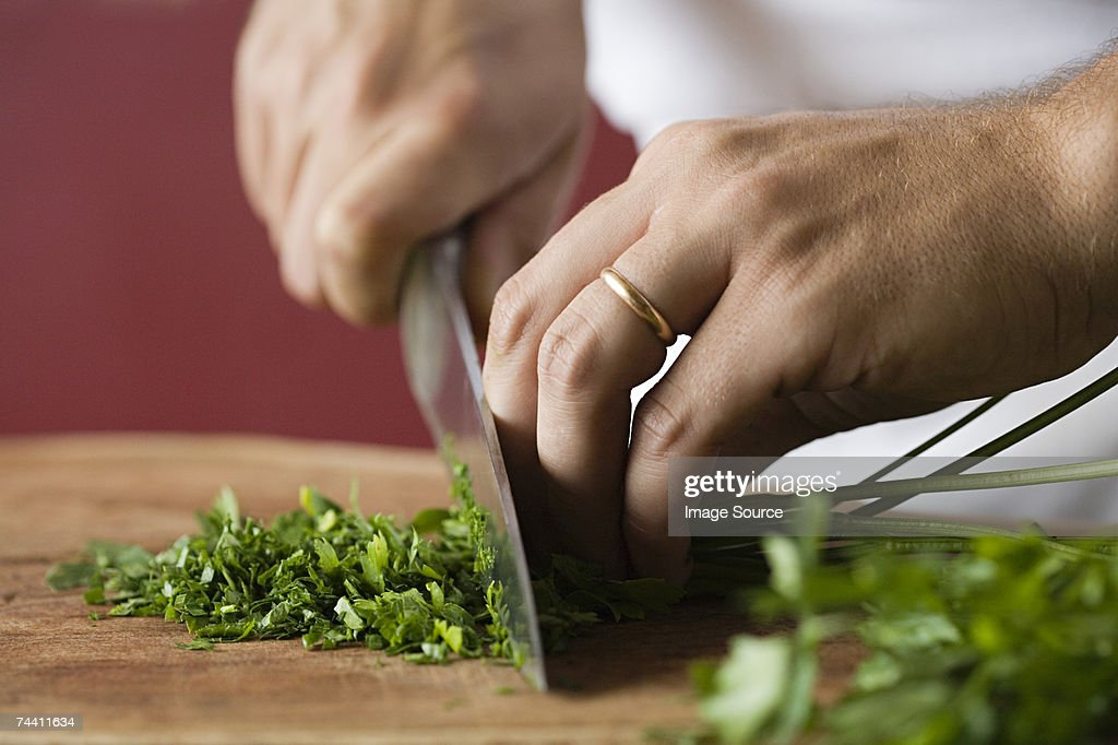 Person chopping parsley : Stock Photo