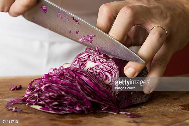 Person chopping red cabbage