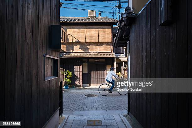 A person cycles along street of Gion