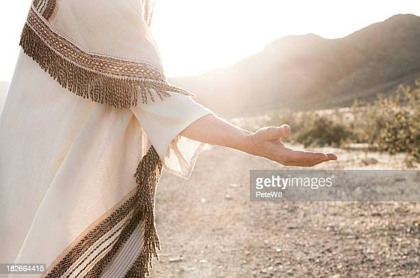 Person depicting Jesus and reaching hand out
