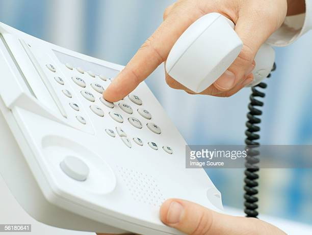 Person dialing telephone