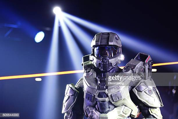 A person dressed as a Master Chief a character from the Halo video game franchise stands in the auditorium as fans watch professional videogame...