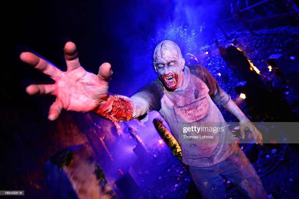 A person dressed as a monster poses amongst graves at Frankenstein castle on October 19, 2013 in Darmstadt, Germany. Grotesque monsters, howling werewolves, long-nosed witches and Frankenstein's monsters feature in the annual weekend event at the castle, which is now one of Europe's most popular Halloween events. The festival started in 1978 after American troops stationed at Rhein Mein Air Base decided to use the famous castle as a venue for hallowen celebrations.
