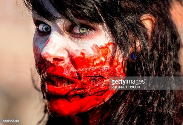 A person dressed as a zombie takes part in a Zombie Walk in the northern French city of Lille on October 1 2014 AFP PHOTO/PHILIPPE HUGUEN