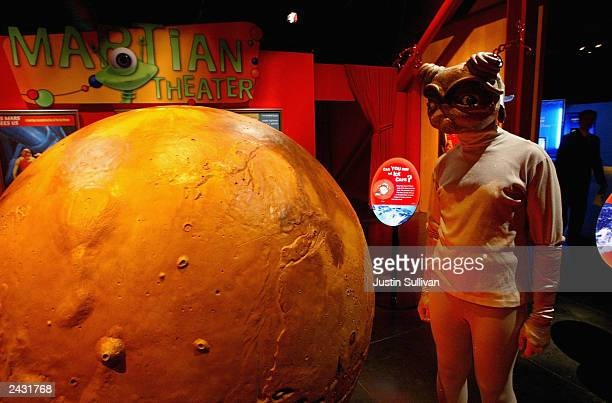 A person dressed as an alien attends the Mars Encounter exhibit at the Chabot Space and Science Center August 26 2003 in Oakland California Hundreds...