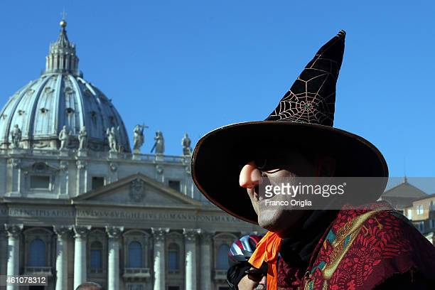 A person dressed as Befana waits in St Peter's Square during the Feast of the Epiphany for Pope Francis' Angelus blessing on January 6 2015 in...
