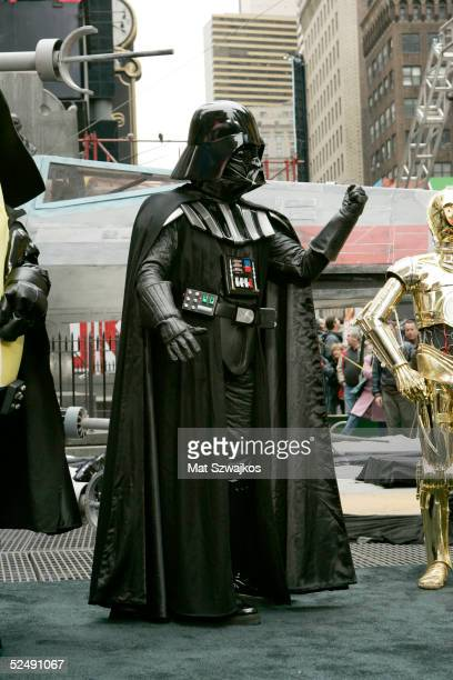 A person dressed as Darth Vader attends the unveiling of the new MM Star Wars candy in Times Square March 29 2005 in New York City