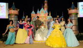 A person dressed as Princess Tiana is joined on stage by all of the princesses of Disney movies during Princess Tiana�s official induction into the...