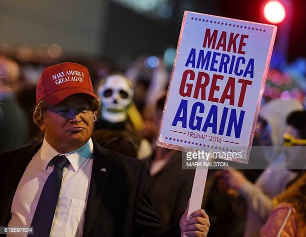 A person dressed as Republican presidential nominee Donald Trump parades along Santa Monica Blvd during the annual street Halloween festival in West...