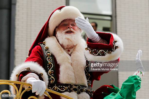 A person dressed as Santa Claus waves from a float during the 90th Macy's Annual Thanksgiving Day Parade on November 24 2016 in New York City...