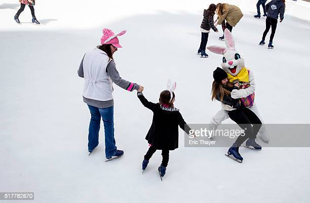 A person dressed as the Easter Bunny ice skates at the rink at Rockefeller Center during the Easter Parade and Bonnet Festival along 5th Avenue March...