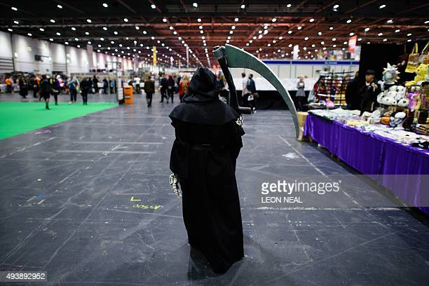 A person dressed as the Grim Reaper arrives at the MCN Comic Con in east London on October 23 2015 The event is the largest of it's type in the UK...