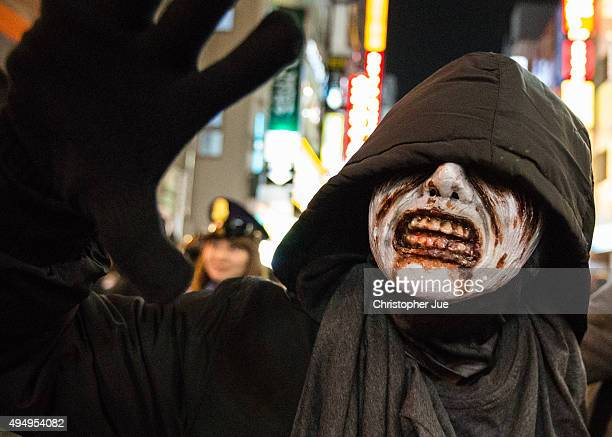 A person dressed in a Halloween costume gathers in Tokyo's Shibuya district on October 30 2015 in Tokyo Japan Tokyo metropolitan police is expected...