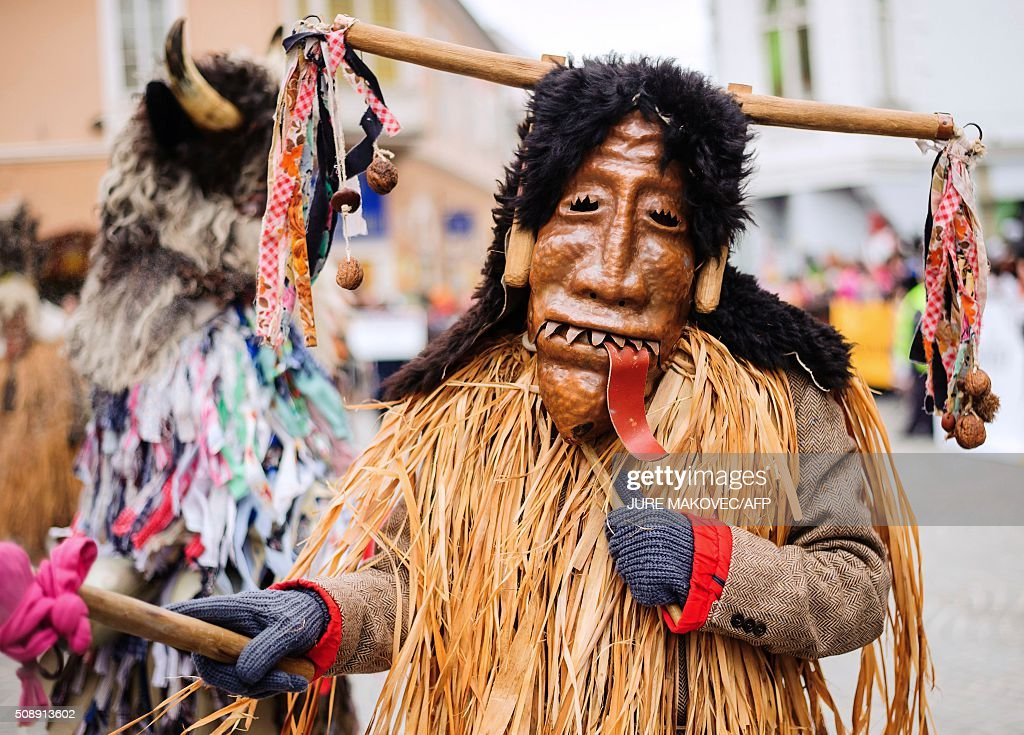 A person dressed in traditional Slovenian Bajer costumed parades during the Ptuj carnival in Ptuj, on February 7, 2016. The Ptuj carnival is the largest in Slovenia and last 11 days. / AFP / Jure Makovec/AFP