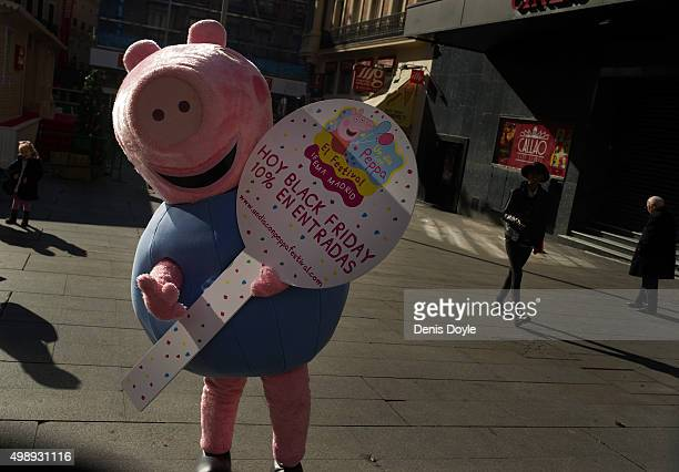 A person dressedup as 'Peppa La Cerdita' a well known Spanish children's animation television programme advertises 'Black Friday' discounts for...