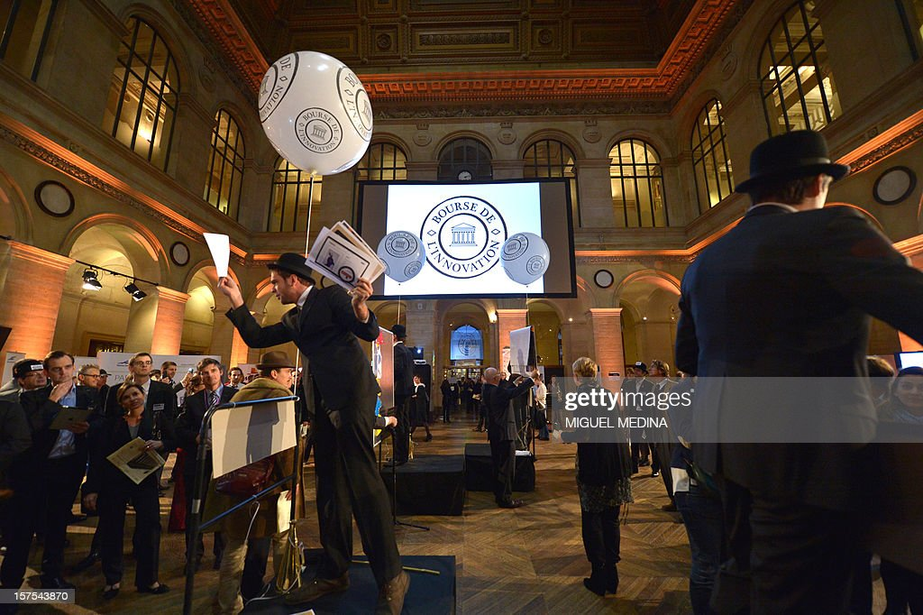 A person dressesed in historic garb hands out leaflets at the Palais Brongniard in Paris on December 4, 2012 during the launch of the first 'Innovation stock market' where 40 start-ups were symbolically quoted on the exchange. AFP PHOTO / Miguel MEDINA