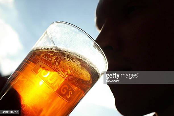 A person drinking a pint of beer at a Young Co's Brewery