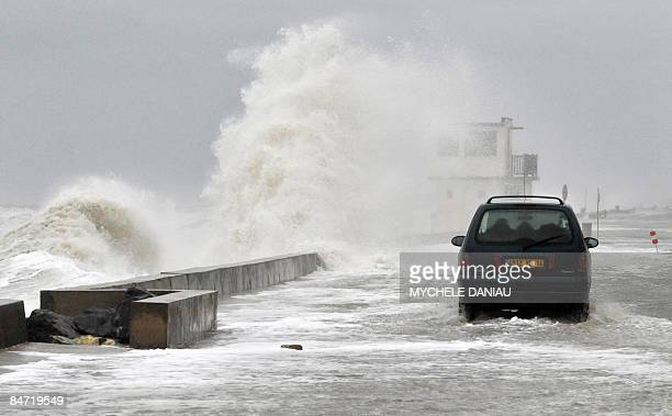 A person drives a car on the flooded seafront on February 10 2009 in VersurMer western France as hurricaneforce gusts up to 140 kilometres per hour...