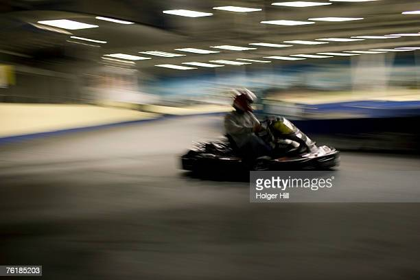 Person driving a go-cart on a race track