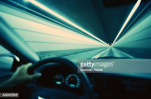 Person driving through tunnel, close-up (blurred motion) : Stock Photo