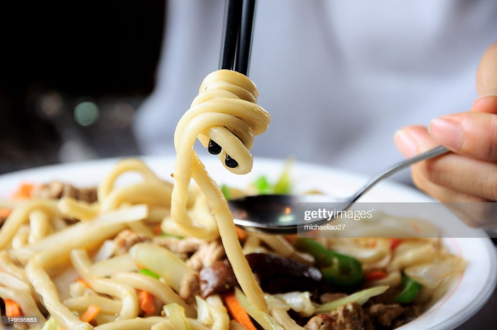 Person eating noodles : Stock Photo