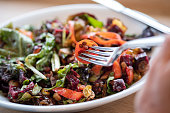 Healthy vegan salad with brussel sprouts, beets, salad greens, carrots, tomatoes, lentils.  Vancouver, British Columbia, Canada