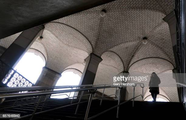 A person enters the Brooklyn Bridge subway station on March 24 2017 in New York City