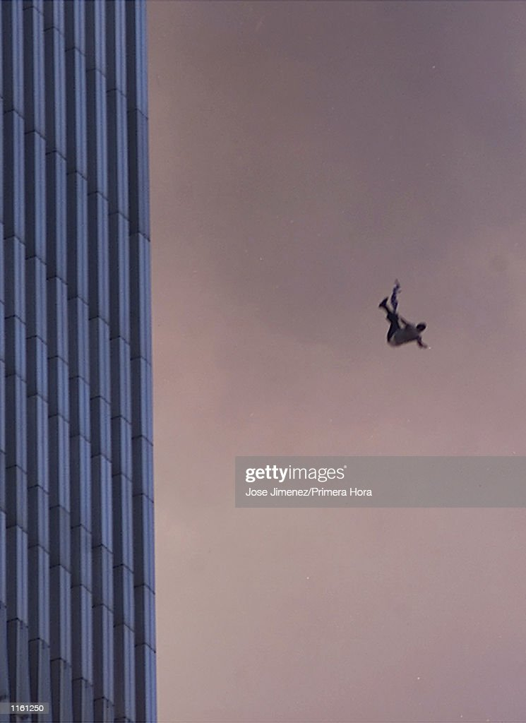 A person falls to his death from the World Trade Center after two planes hit the Twin Towers September 11, 2001 in New York City.