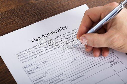 Person Filling Visa Application Form Stock Photo | Thinkstock