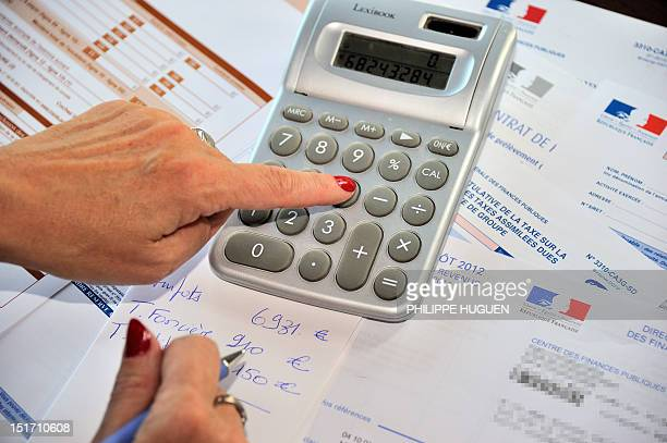 A person fills out a tax declaration for the 2012 income tax on September 10 2012 in Lille northern France AFP PHOTO PHILIPPE HUGUEN