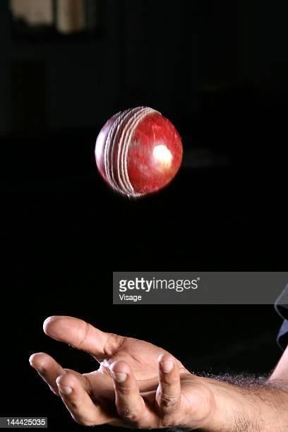 Person flinging a Cricket ball