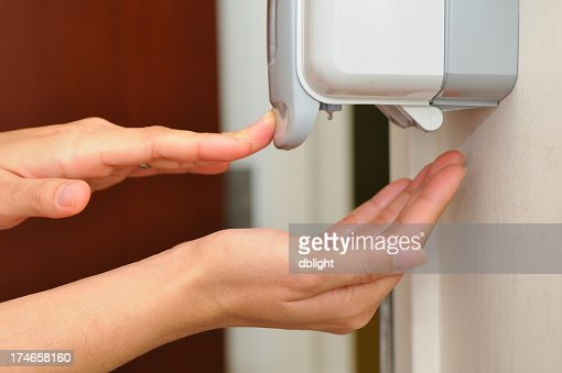Person getting soap from a hand dispenser