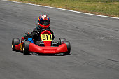 Person go-carting on a motor racing track