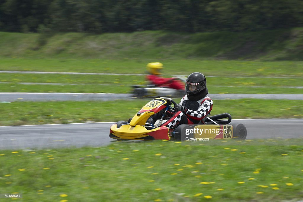 Person go-carting on a motor racing track : Foto de stock