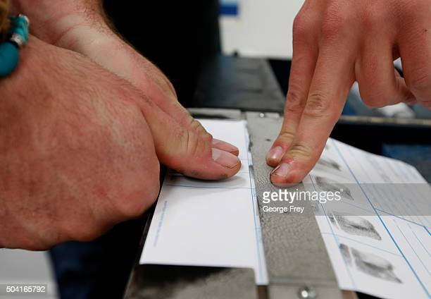 A person has his fingerprints taken as part of a Utah concealed gun carry permit class at Range Master of Utah on January 9 2016 in Springville...
