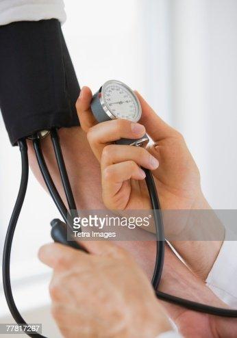 Person having blood pressure measured : Stock Photo