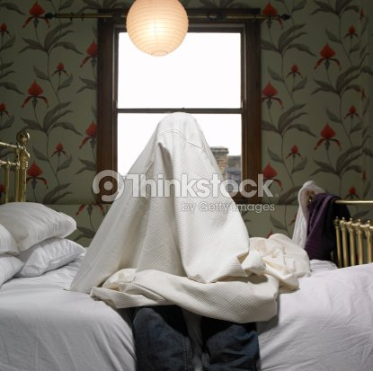 Person Hiding Under Sheet On Bed Stock Photo Thinkstock