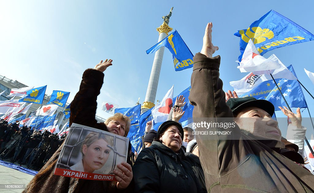 A person hold a placard bearing a picture of jailed former Prime minister Yulia Tymoshenko during a rally called by Ukrainian opposition 'against political repression!' on Independence square in Kiev on February 25, 2012, on the day of the start of the 16th Ukraine-European Union summit in Brussels. AFP PHOTO/ SERGEI SUPINSKY