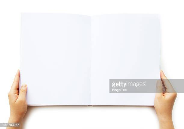 A person holding a blank book of paper
