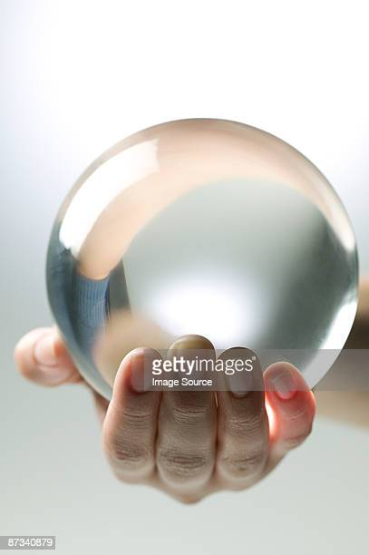 A person holding a crystal ball