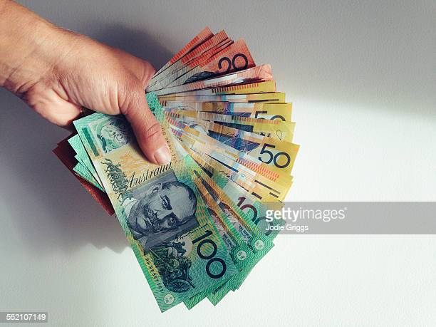 Person holding a large sum of money in hand