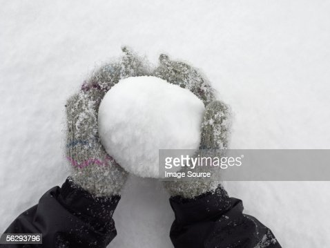 Person holding a snowball