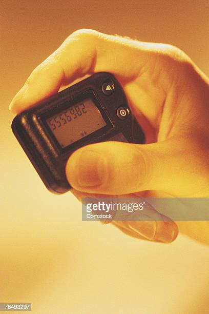 Person holding beeper
