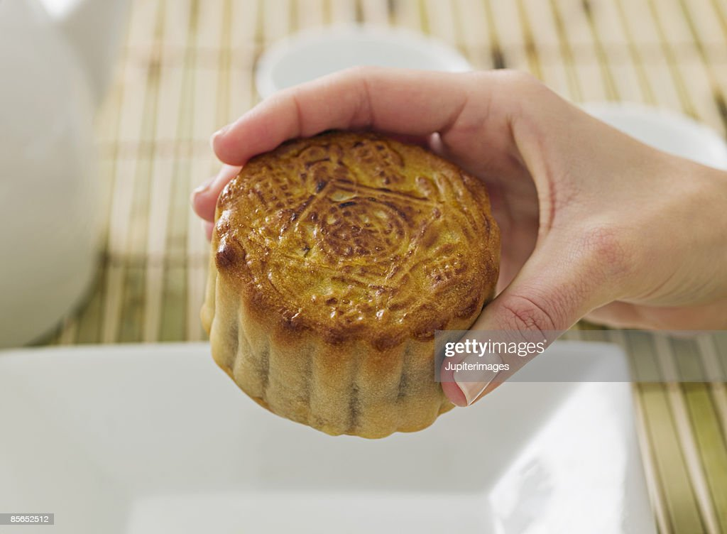 Person holding Chinese moon cake : Stock Photo