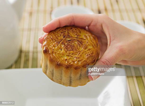 Person holding Chinese moon cake